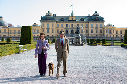 The King and Queen in Drottningholm Palace Park with their dog, Brandie